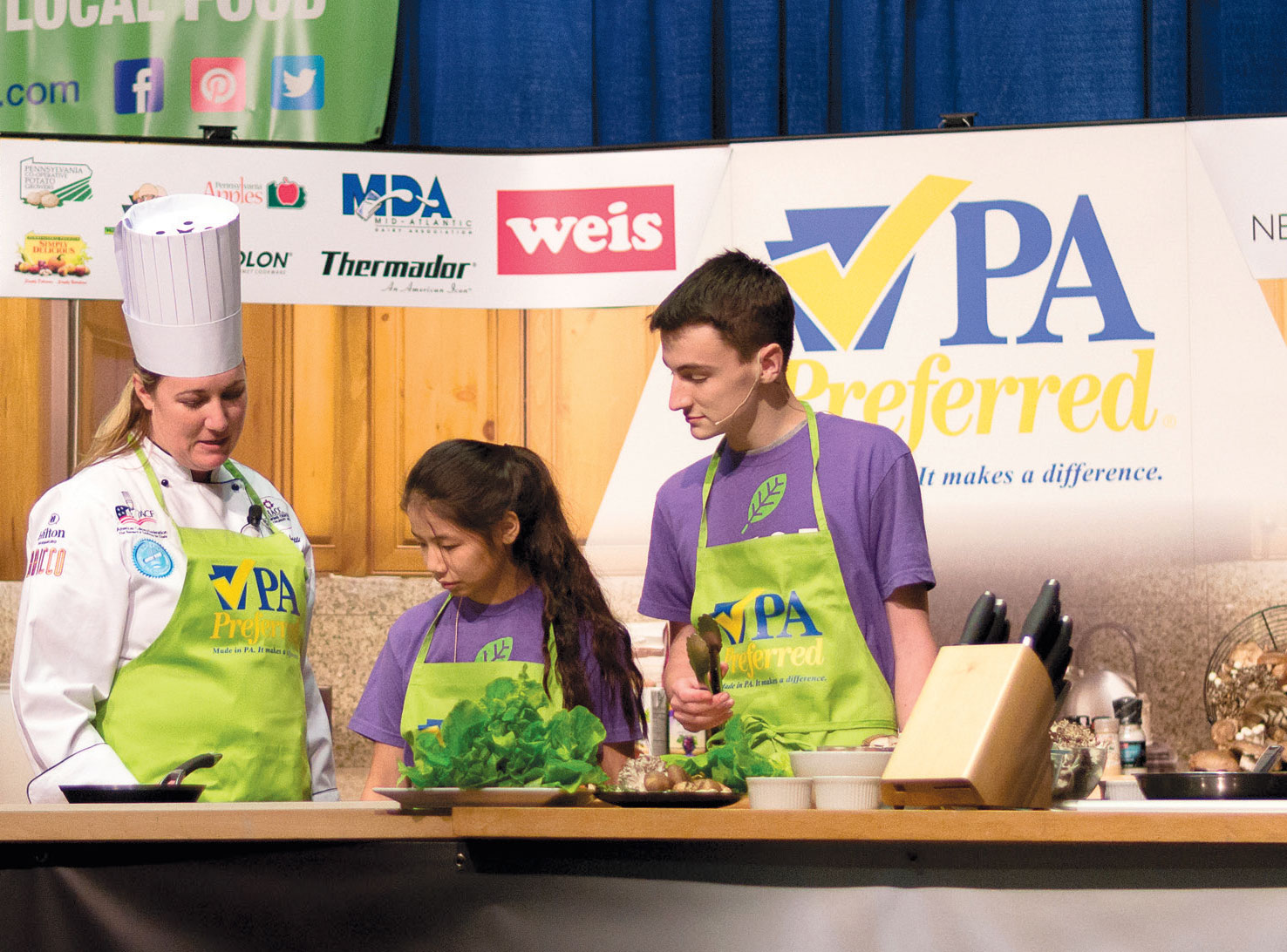 Students from the L.E.A.F. youth leadership program join Chef Autumn Patti on the Culinary Connections stage