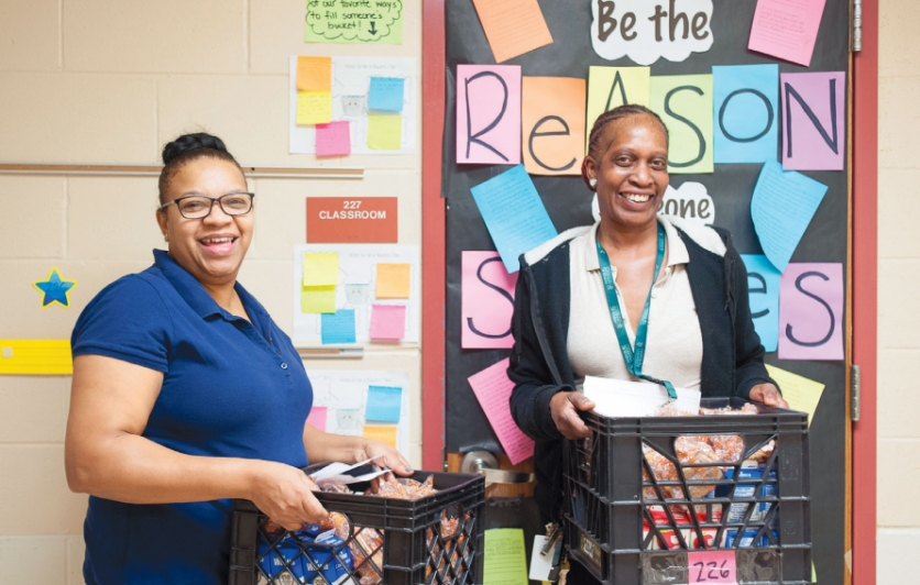 Marlow Williams (left) and Brenda Walton deliver breakfast to every classroom at H.A Brown School each morning.