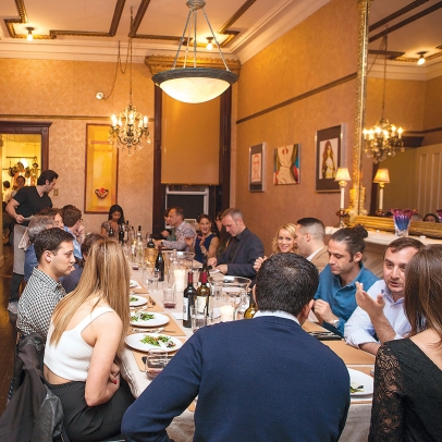 Diners gather around the table at Boku