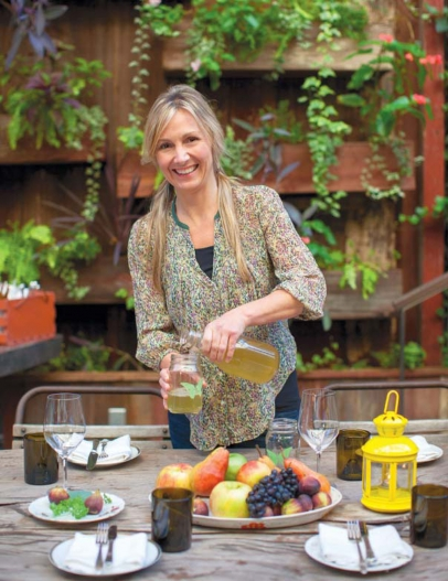 Aimee Olexy readies a table at Talula's Garden on Washington Square.