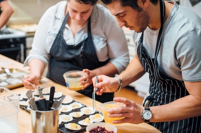 Sydney Hanick and Ryan Fitzgerald plate a dish at Boku