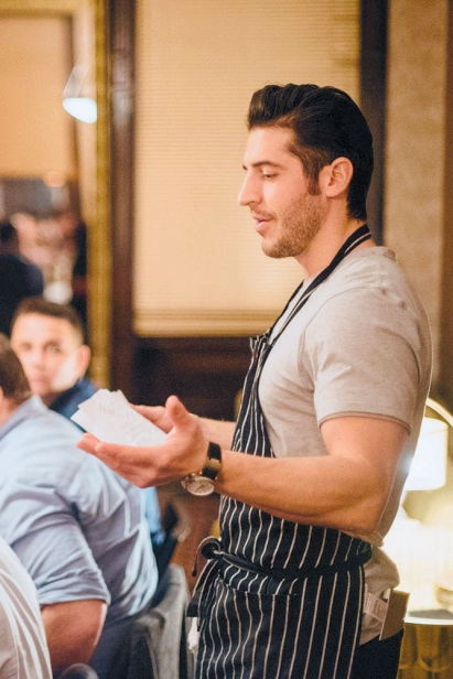 Ryan Fitzgerald presents the menu to diners at Boku