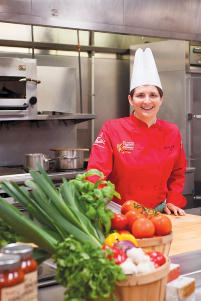 Carrie Welt of Cambell's Culinary Baking Institute stands in a kitchen at Campbell's in Camden, NJ