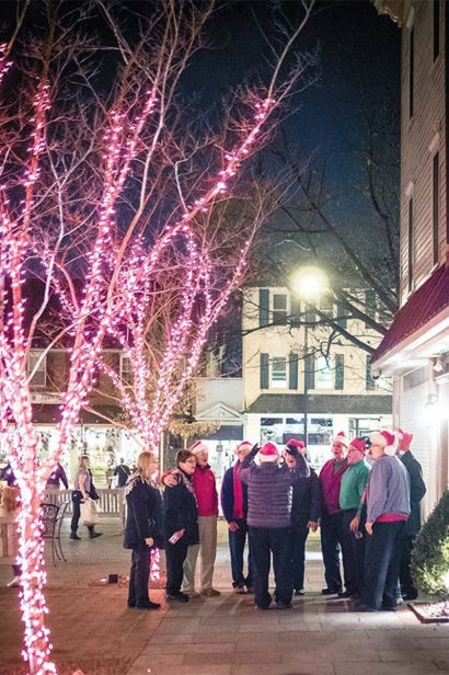 Christmas carolers gather in Kings Court