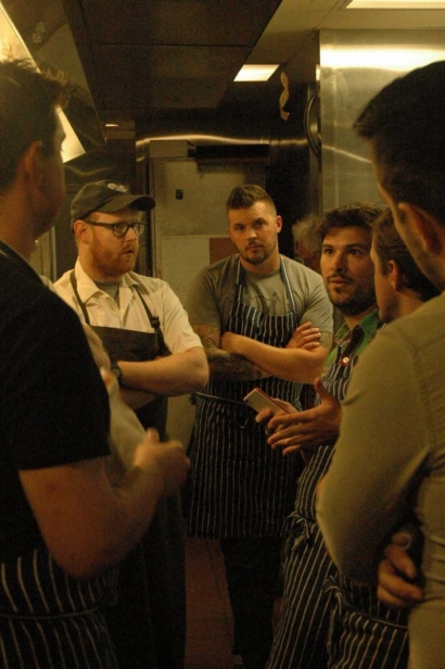 Kitchen Staff in a pre-dinner meeting