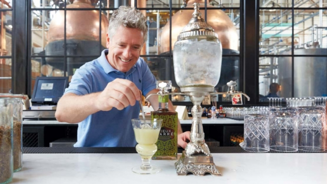 Andrew Auwerda preparing a classic absinthe cocktail with Philadelphia Distilling's Vieux Carré